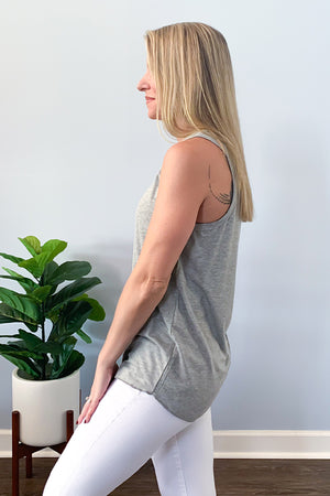 Stay comfy and cute with our Grey Rose Basic Scoop Neck Tank Top! This relaxed fit tank features super soft knit fabric, ribbed band neck and sleeves, and raw hemming hem.  Perfect for layering or wearing as is and is long enough to tie or front tuck.