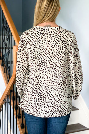 The perfect blouse for everyday wear!  Our Leopard Print Balloon Sleeve Blouse features an all over leopard print, v-neckline, and 3/4 balloon sleeves.  Dress it up or down for work or a cute date night outfit!  This versatile top is perfect for any season! Pair with your favorite jeans and cute booties for a fall outfit! Beeson River.