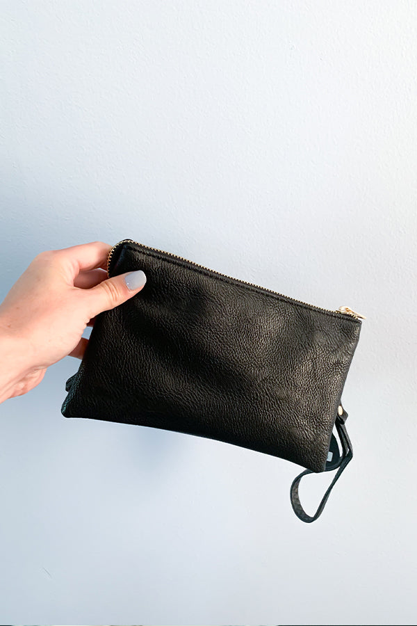 The perfect crossbody bag for year round!  This Black Crossbody Bag includes a crossbody strap and a wristlet strap that are both removable.  Wear as a clutch or wear as a crossbody.  There is an internal zip compartment along with credit card slots.  The perfect purse to grab and go.