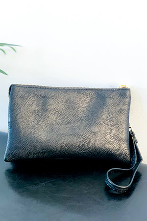 This Black Crossbody Bag includes a crossbody strap and a wristlet strap that are both removable.  Wear as a clutch or wear as a crossbody.  There is an internal zip compartment along with credit card slots.  The perfect purse to grab and go.  Also, check out our cream, leopard, and snake print bags.