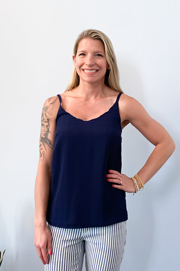 Our Navy And Blush Reversible Tank is the perfect cami for this season! Beautiful blush, navy, and white stripes on one side or wear reversible as solid navy.  Lightweight and spaghetti straps make this top perfect for wearing under a cardigan to the office or wearing with your favorite white denim for a fun, date-night dinner outfit.