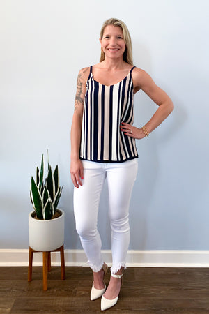Our Black Tape Navy And Blush Reversible Tank is the perfect cami for this season! Beautiful blush, navy, and white stripes on one side or wear reversible as solid navy.  Lightweight and spaghetti straps make this top perfect for wearing under a cardigan to the office or wearing with your favorite white denim for a fun, date-night dinner outfit.