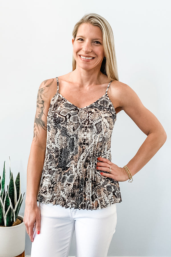 Looking for a tank you can live in this summer? OMG, then this Snake Print Pleated Tank by Black Tape is what you need! The pleats of this relaxed fitting cami add an amazing texture that makes it so flattering! So cute paired with white jeans and a cute sneaker or pair with some heels for a night out with your babe!