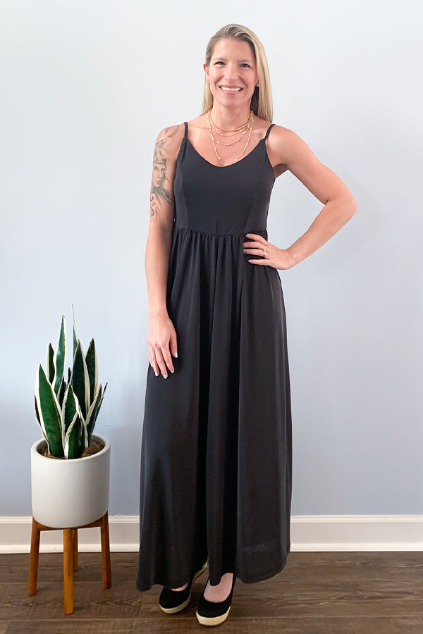 Mystree Black Wide-Leg Jumpsuit. We're loving this comfy jumpsuit!  The Black Wide-Leg Jumpsuit features adjustable thin straps and made with an unbelievably soft fabric.  This chic jumpsuit is perfect for a fun day in the park or pairing with your favorite denim jacket to grab lunch with your bestie. Either way, you'll feel comfy all day long!