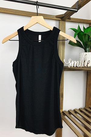 We've got the perfect layering tank for you! The Black Ribbed Racerback Tank is perfect for dressing up or wearing casual. This stretch rib knit tank features a round crewneck and round hem.