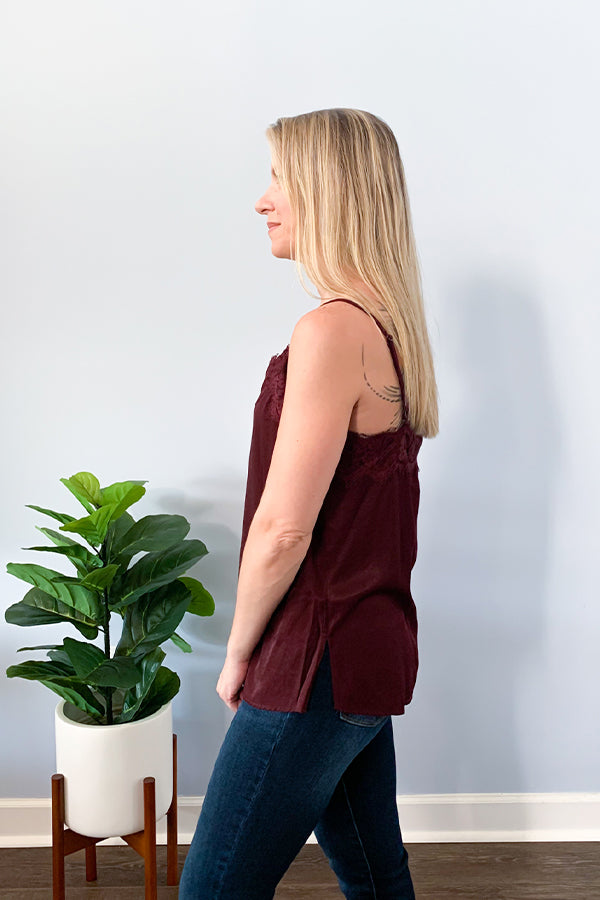 Our Burgundy Lace Trim Button Up Cami Top is a closet-essential! Perfect for pairing underneath a cozy cardigan or chic blazer!  This dainty cami top features lace trim around the front and back, functional front buttons, and adjustable straps.  This cami is made with a lightweight fabric that is soft and has a satin feel to it.  Pair with your favorite cozy cardigan, jeans and booties for a cute outfit.  Change out your jeans with some leather leggings for a chic dinner outfit!