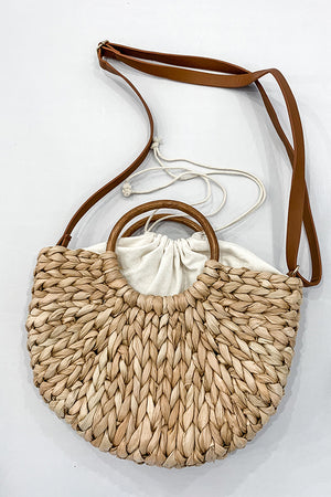 Add a chic finishing touch to your summer wardrobe with our Circle Handle Straw Clutch Bag.  This twist knotted straw bag features a wooden handle, fully lined, drawstring lined closure, and an inner small pocket.  Wear as a clutch or wear over your shoulder with the adjustable strap.  This is the cutest bag you'll own this season!  Trust me!