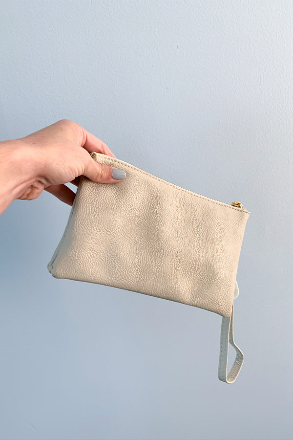 The perfect crossbody bag for year round!  This Cream Crossbody Bag includes a crossbody strap and a wristlet strap that are both removable.  Wear as a clutch or wear as a crossbody.  There is an internal zip compartment along with credit card slots.  The perfect for purse to grab and go.