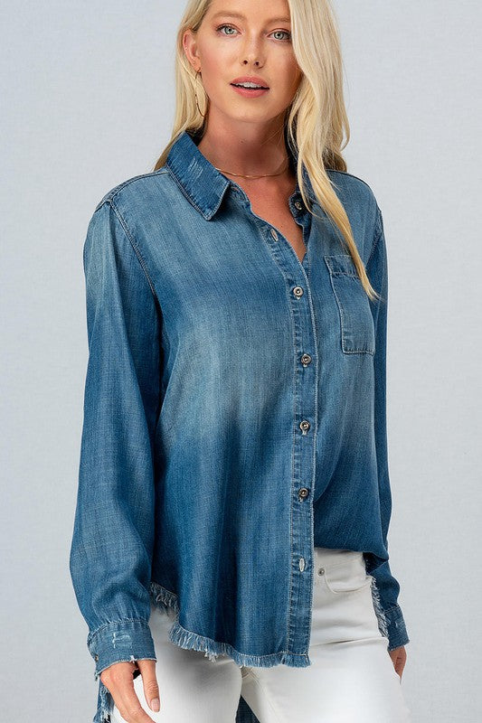 We love the classic, edgy, look of our Dark Wash Frayed Hem Denim Shirt.  This soft lyocell fabric top features a high-low frayed hem, minimal distressing through out, front bust pockets, and button closure.  The perfect fall essential for your every day wardrobe!  Perfect for pairing with leggings and your favorite sneakers!  Dress it up with skinny jeans and booties for a fun, fall outfit!