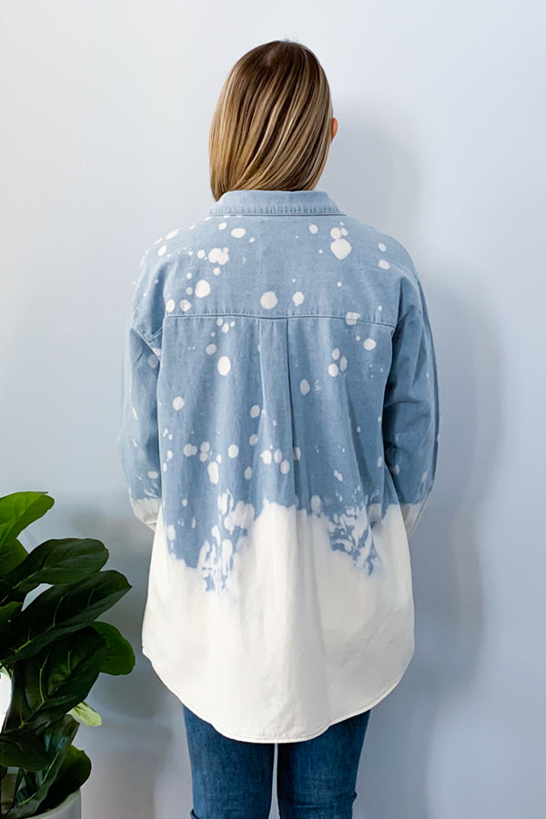 Wear it as a shirt or as a jacket!  Either way, you're going to love the effortless look of our Acid Wash Denim Button Down Shirt. We're loving the fun white bleached out bottom on a light wash denim top.  This top has an oversized fit so it's easy to throw on as a jacket or wear as a comfy shirt.  Pair with a waffle knit top, flares, and booties to complete the look.