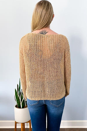 Dex Black Tape Gold Crochet Sweater We're loving this chic Gold Crochet Sweater.  Designed with beautiful gold crochet fabric, crew neckline, and slightly cropped hem that hits perfectly at the hip.  Perfect for pairing with high-waist jeans and booties.  This sweater is see through and is perfect with our Satin Brown Night Out Cami.