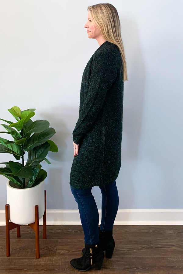 We are in love with this beautiful cardigan by Dex.  This Boucle Open Sweater Cardigan In Black Pine Speckle is a hunter green cardigan with speckles of black and blue throughout.  Perfect for dressing up or down.  Pair with jeans for a casual outfit or dress up with faux leather leggings and booties for a dressier look.
