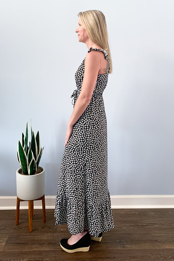 The Dex Daisy Maxi Dress is a must-have for this season!  Black and white daisy print maxi dress featuring ruffle strap details, functional button front, and a tie waistline just below the bust.  This dress is made with a stretchy fabric and is so comfy, you'll want to wear this all spring and summer.  Pair with your favorite wedge sandals for a cute brunch outfit.  Pair with some fresh white sneakers for a casual, comfy day outfit.