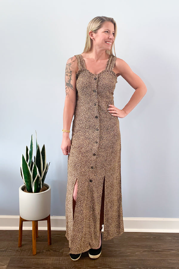 The Dex Leopard Dot Maxi Dress is the perfect lightweight dress for spring and summer.  Featuring a fun cheetah/leopard print with ruffle details around the chest, functional button front, and two front slits.  Perfect to pair with a denim jacket and your favorite wedge.  Create an edgier outfit with combat boots and a cool graphic tee!