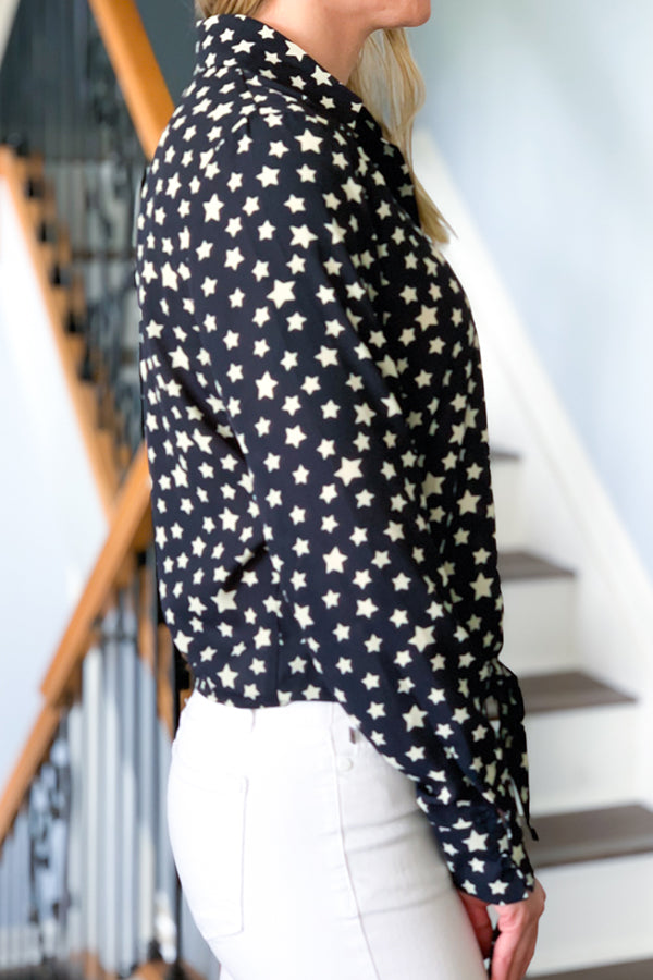 The Navy Long Sleeve Star Print Blouse is just what you need for that work to dinner blouse.  Featuring a navy base with off-white star print, long sleeves with button cuff closure, and button down with tie front.  Pair this top with your favorite white denim for a cute spring time outfit.  Wear sleeves long or roll them up for a different look. Dex Clothing.