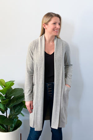 Chilly nights by a fire call for our Soft Heather Grey Fleece Cardigan by Dex.  This fleece cardigan is super soft that you'll want feel cozy, while looking chic!  This open front cardigan features front pockets and shawl collar.  Pair with a cami, skinny jeans, and cute booties for the cutest outfit!
