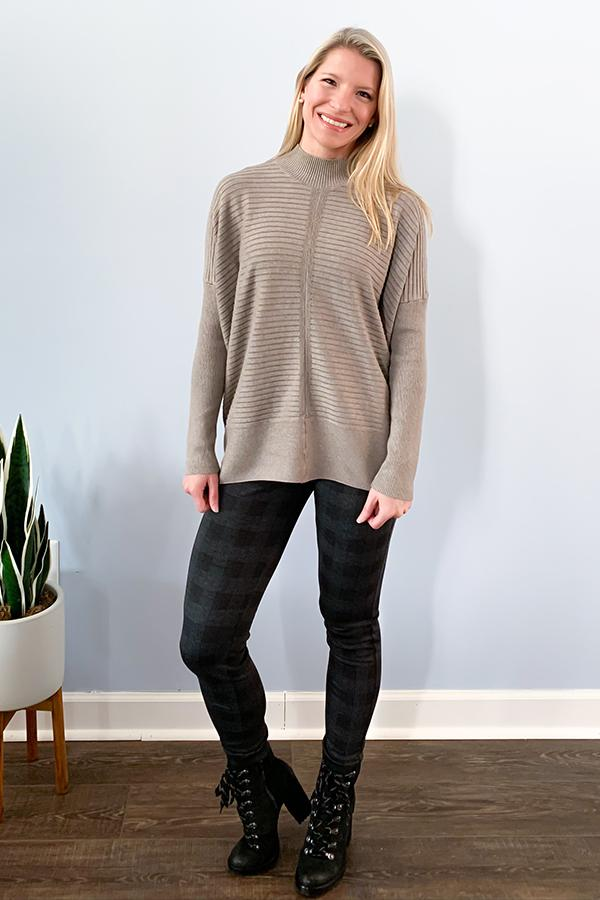 Our Taupe Drop Shoulder Long Sleeve Sweater will get you ready for chilly weather.  This soft, stretchy sweater features a ribbed fabric detail, mock neck,and drop shoulder long sleeves.  Perfect for pairing with leggings or your favorite pair of denim. Dex Clothing brand.