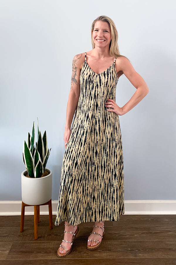 The Dex Tie Dye Snake Print Maxi Dress features a v-neckline, adjustable straps, and a cute tie-back detail.  Made with stretchy fabric, this dress is super cute and comfy for all-day wear.  This dress is so cute with wedge sandals and a denim jacket.  Definitely a go-to for an effortless outfit.