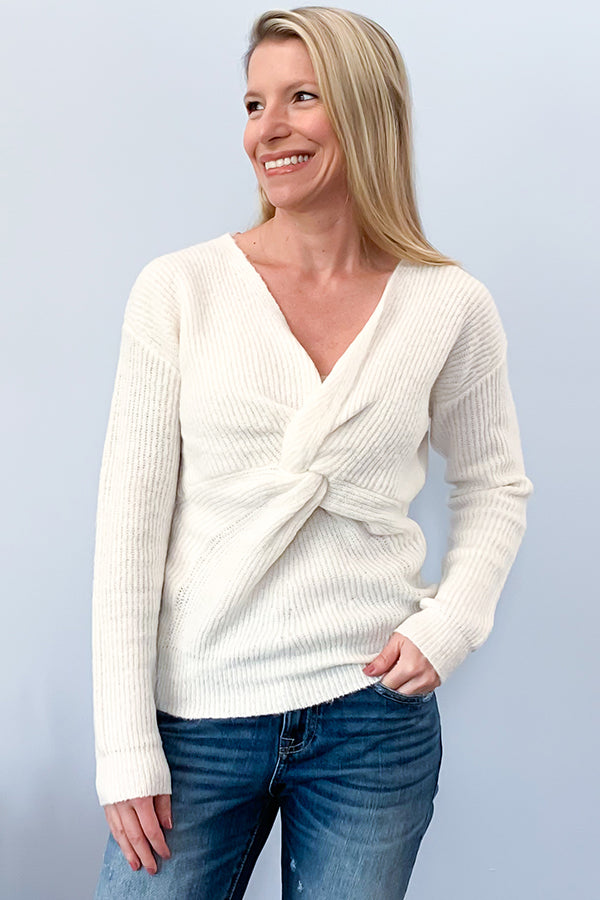 Bring on ALL the cozy fall sweaters! We've got the perfect one! Beautiful off-white, long-sleeve, sweater featuring a v-neckline and cute twist front detail. I just love this feminine sweater! How cute will this be paired with your favorite denim and cutest booties! So chic! Pair it with a cute denim skirt and tall boots for a fall, date night outfit. Dex Sweater