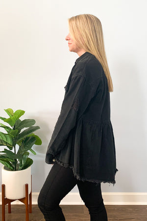 Add the perfect amount of edge to your outfit with our Distressed Denim Button Down Shirt Jacket! Cute washed black denim jacket featuring snap front closure and cuff closure, frayed hemline, and distressing.  We love the peplum style of this relaxed fit jacket which gives it a fun feminine look!  Wear as a jacket or button up to wear as a shirt!