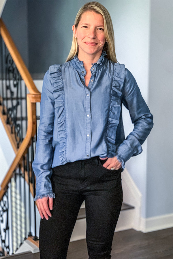 Elevate your outfit with our Long Sleeve Ruffle Denim Blouse by Elan.  This chic denim blouse features a mock neck with raw hem detail, ruffle detail along the front, and snap closure.  We are loving all the little details in this top including the raw hem cuffs with snap closure.  This soft denim top has a slight hi-low hem and is perfect for wearing over leggings or tucked in with your favorite jeans!