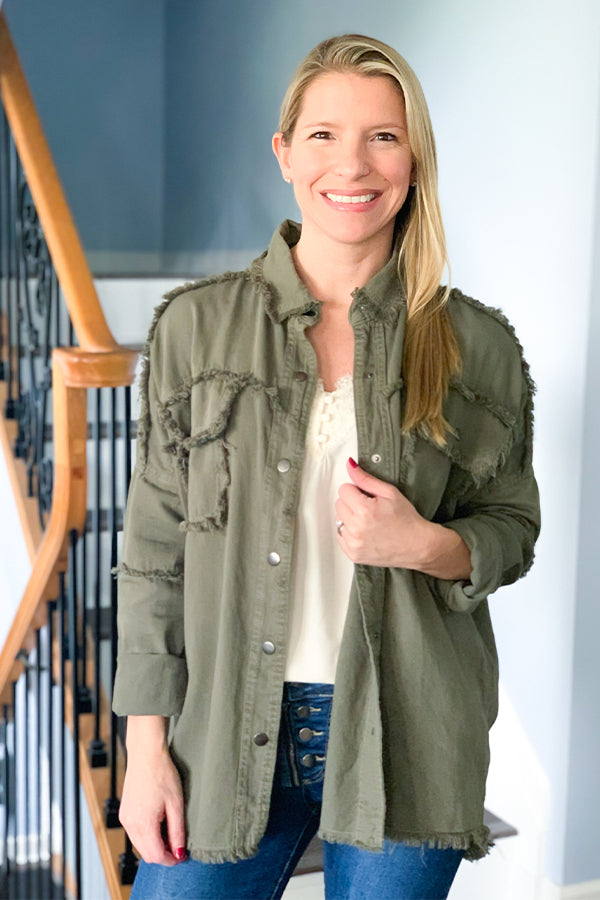Show off your rocker style with our Rock And Roll Jacket by Elan!  This button up military style jacket features raw edges and hemline, snap button closure, and drop shoulder seam.  We love the relaxed fit of this lightweight jacket.  Perfect for any season!  Wear open as a layering piece or closed.