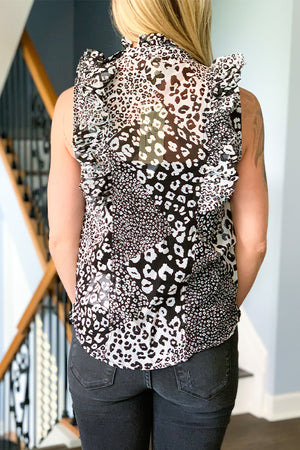 Our Elan Sleeveless Ruffle Leopard Top is the perfect work to weekend top!  Featuring a black and white leopard print with ruffle detail along arms and neck.  This high neck blouse is semi sheer and has two button closure at neckline. Pair this top with black pair of denim for a chic outfit! Wear buttoned up for a high neck look or leave unbutton for an different look.