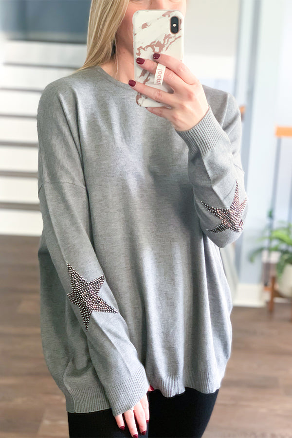Our Star Embellishment Long Sleeve Sweater by Elan is simply amazing!  Soft, stretchy fabric, round neckline, and cute embellished stars on the outer sleeves make this sweater a must-have for fall!  Perfect for pairing with leggings.  This cute sweater has a relaxed fit and is one size fits most.