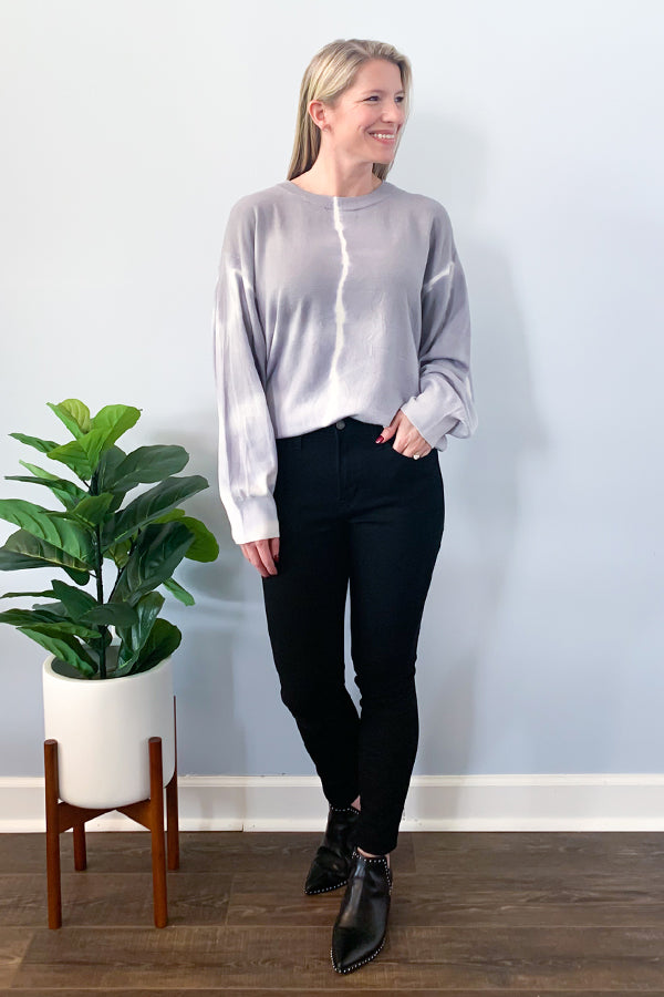 Stay cozy and trendy with our super soft Tie Dye Long Dolman Sleeve Sweater by Elan.  Featuring a crew neckline, grey tie dye print, and long dolman sleeves.  This sweater is one size and so chic! Pair with black jeans and cute booties for a fall outfit.