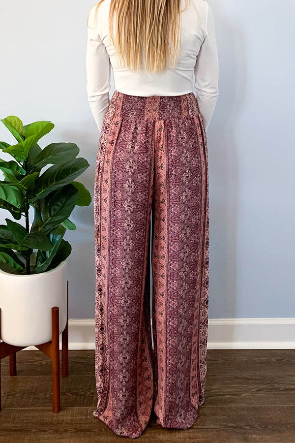 Our Berry Tribal Print Wide Leg Pants feature a vibrant tribal floral print in pink, purple, burgundy, and small tints of green.  These wide leg pants feature an elastic high rise waistband, side pockets, and are lined.  Pair with our henley bodysuit or a basic tee for a cute outfit.  Dress up or wear casual, they are perfect for all occasions.