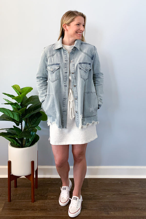 The perfect distressed jacket is here! Our Distressed Oversized Denim Jacket in Light Wash features the cutest side pockets, bust pockets, button down closure, and distressing detail.  We are loving the longer length of this jacket, perfect for pairing with leggings and sneakers!  Throw over a cute dress and booties for a fun, casual outfit!