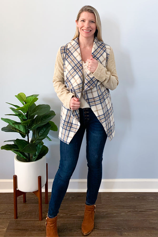 We are seriously in love with our Plaid Wrap Jacket With Corduroy Sleeves!  This piece is unique with it's contrast corduroy sleeves and plaid wrap body.  This classy jacket features a trendy plaid design, side pockets, and a detachable belt.  Perfect for pairing with skinny jeans and booties for the cutest outfit this season! Entro