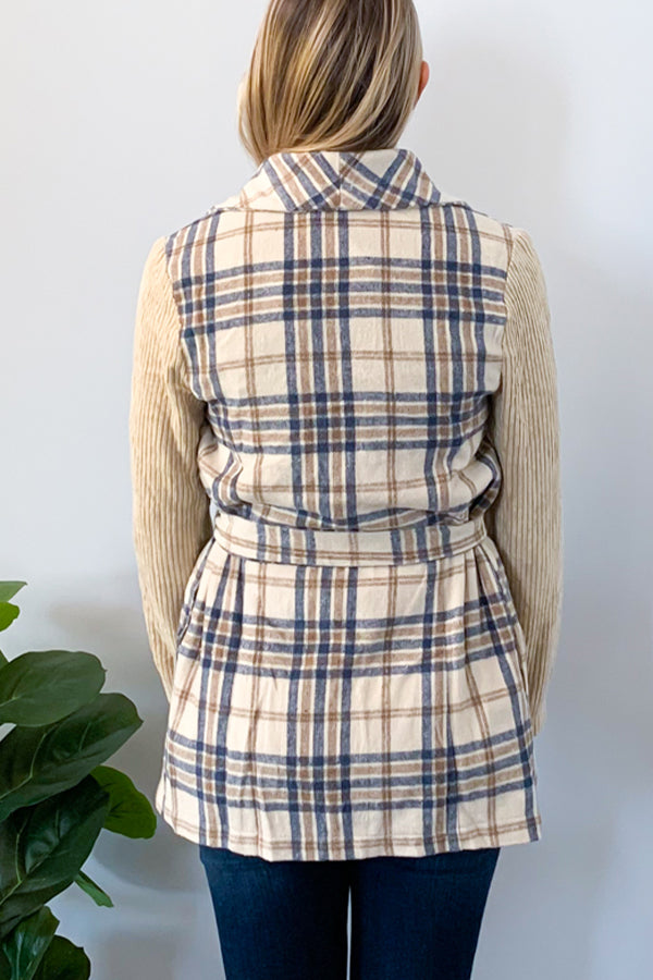 We are seriously in love with our Plaid Wrap Jacket With Corduroy Sleeves!  This piece is unique with it's contrast corduroy sleeves and plaid wrap body.  This classy jacket features a trendy plaid design, side pockets, and a detachable belt.  Perfect for pairing with skinny jeans and booties for the cutest outfit this season! Entro jacket