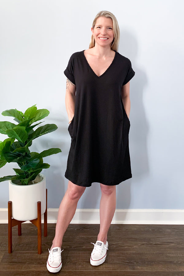 Cute and comfy, our Black V-Neck Cuffed Sleeve T-Shirt Dress is the perfect dress for a casual day in the sun!  This t-shirt dress features super soft fabric, relaxed fit, and side pockets.  Pair with a denim jacket and cute wedges for the cutest brunch outfit.