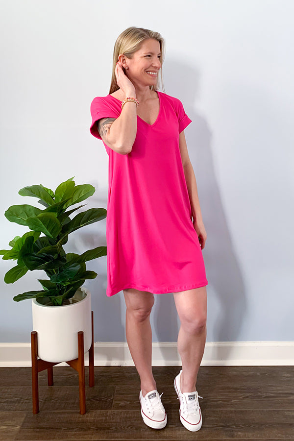 Add a pop of color to your closet with our Fuchsia Pink V-Neck Cuffed Sleeve T-Shirt Dress. This t-shirt dress features super soft fabric, relaxed fit, and side pockets.  Pair with heels and accessories for the cutest date night outfit.