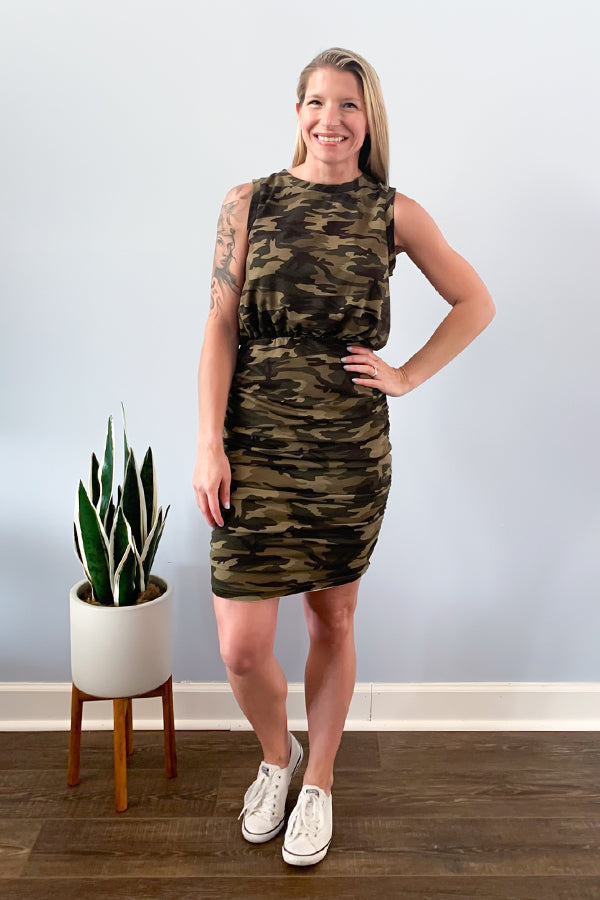 Look super cute in our Camo French Terry Ruched Dress.  This tank dress has a billowy type top and is cinched from the waist down to the hem.  Perfect for wearing casual with sneakers or dressing up with heels.  Details  Stretchy Fitted Ruched Sides Elastic Waist Crew Neckline Tank Mini Dress Camo Colors: Green, Tan, and Black Not Lined / Not Sheer