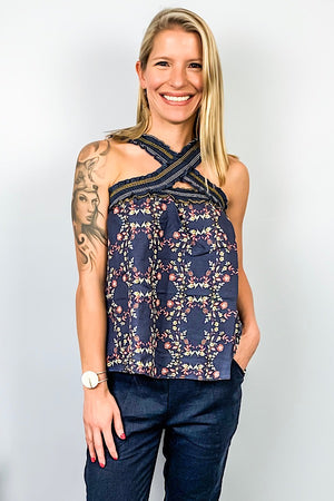 Beautiful Floral Cross-Front Sleeveless Top featuring all over floral pattern, criss cross front straps, and elastic smocked straps and bust. Perfect top to dress up or down. Pair with a blazer for a 9-5 outfit or wear with your favorite denim for a casual style.
