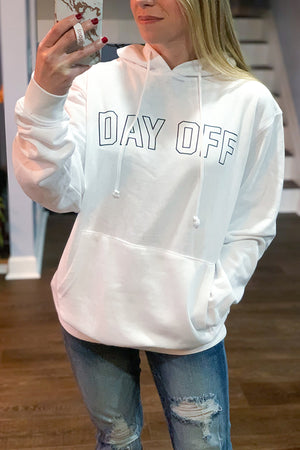 Whether you have the day off of work or just taking a break from the kiddos, you'll love this Day Off Hooded Sweatshirt by Friday + Saturday!  Super cozy sweatshirt featuring front pockets, hoodie with drawstring, and a comfy oversized fit.  We love pairing this graphic sweatshirt with our faux leather leggings or distressed jeans.