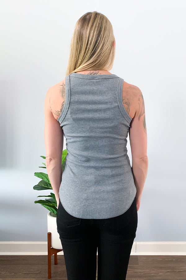 The best tank you'll ever own is here! The Grey Ribbed Racerback Tank is perfect for dressing up or wearing casual. This stretch rib knit tank features a round crew neck and round hem.  Perfect for layering under a cute jacket or cardigan for fall or wear as is for those warm days.
