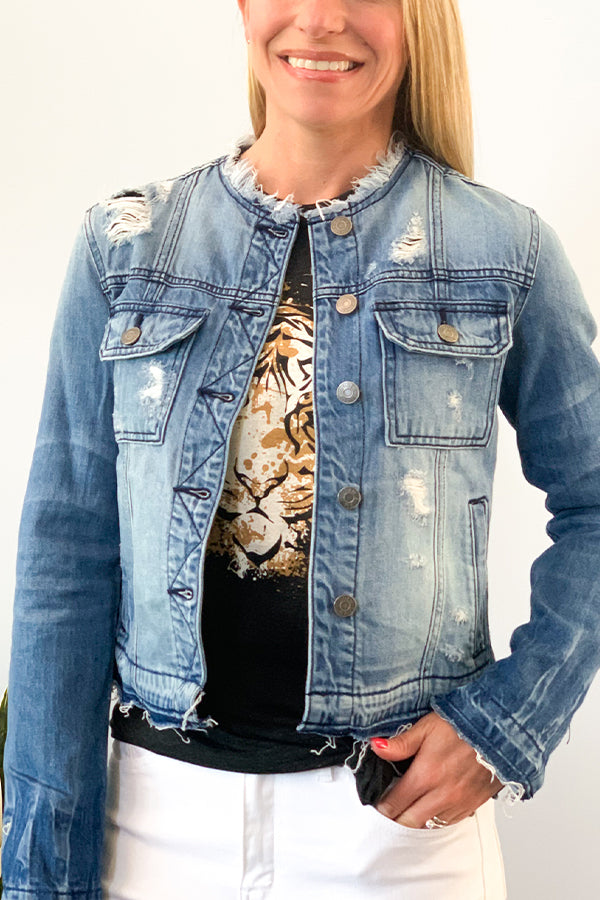 Add some edginess to your outfit with our Hidden Collarless Distressed Denim Jacket! This lightweight distressed jacket is perfect for a cool summer evening out on the town or a warm winter day while you're having lunch with your friends.  Collarless, raw edge hems, and heavy distressing add to the uniqueness of your new favorite jacket.