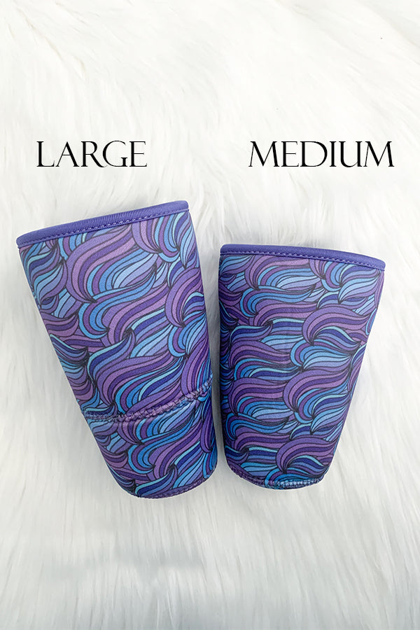 Raise your hand if you don't like drink puddles as much as we do?!  Our Insulated Cup Sleeves are the perfect solution for all your condensation woes.  Keep your hands warm and your drinks ice cold for longer!  This cute Waves print is mixed with beautiful colors of blues and purples.