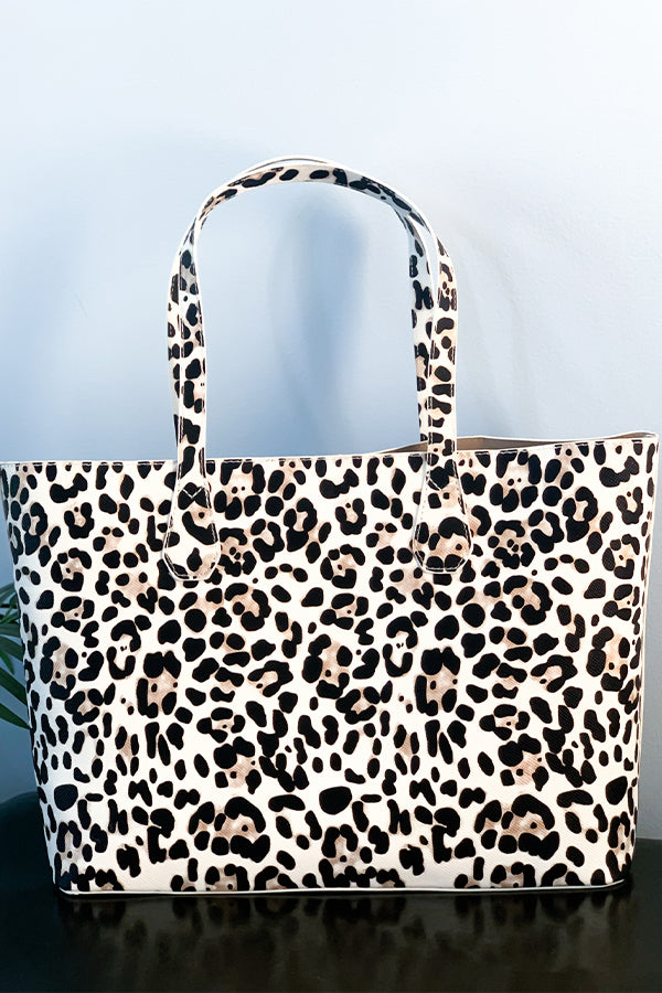 I'm obsessed with this beautiful and classic Ivory Leopard Tote Bag.  Features include soft velvety inside lining, cellphone/accessories pocket inside, and a snap closure.  This shoulder tote is perfect for a school or business bag.  This will be your favorite go-to tote!