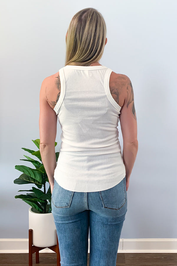 The Ivory Ribbed Racerback Tank is perfect for layering under a cute cardigan this season or wear as is for warmer days!  Features a round crew neck and round hem and made with a stretchy ribbed knit fabric.