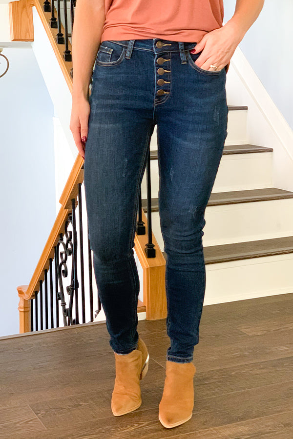 Every pretty lady needs a classic pair of jeans like our Judy Blue Button Fly High Rise Skinny Jeans.  These high-waist skinny jeans feature a trendy button fly, minimal distressing, and a classic 5-pocket style.  These jeans are perfect for dressing up or dressing down and perfect for all seasons!  Pair with a cute sweater and boots for the cutest fall outfit! Recommended to size down if in between sizes.