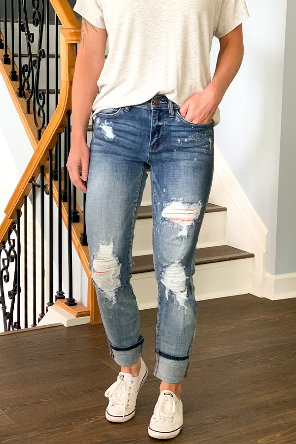 Judy Blue Destroyed Beach Splatter Boyfriend Jean are a must-have this season!! Super cute bleach splatter look with a cuffed hem.  These mid-rise jeans have a nice stretch so if you are in between sizes, you can size down if wanting a tighter fit.  These are true to size and can be worn with the hem cuffed or un-cuffed.  Perfect for pairing with sandals and a tank for a cute, casual summer outfit.