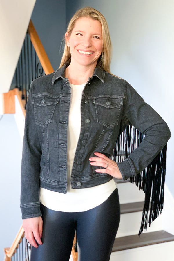 OMG!! This might be our favorite jacket this season!  Our Judy Blue Fringe Jean Jacket features a faded black denim base, long black fringe along the sleeves and back, button closure, and front pockets.  This super comfy jacket is stretchy and perfect for pairing with your favorite skinny jeans or flares!  Details  Suede Like Black Fringe Black Jean Jacket Button Up Closure Collar Front Chest Pockets Side Pockets Stretchy True To Size Fabric: 92.6% Cotton / 6.6% Polyester / 0.8% Spandex Care: Hand Wash