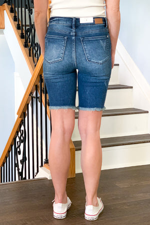 If your looking for a pair of longer length denim shorts, then our Judy Blue High Rise Bermuda Shorts are perfect for you!  Featuring a stretchy, dark denim wash, and raw hems.  These bermuda shorts have a classic 5-pocket design with zipper and button closure.  Perfect for pairing with a tank, kimono, and sneakers for a casual day in the sun! Wear cuffed for a different look!