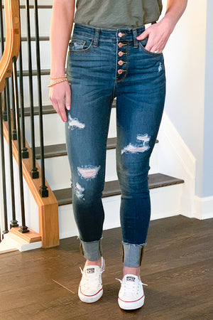 Get your spring on with our Judy Blue High Rise Distressed Button Fly Cuffed Skinny Jeans!  Exposed rose gold button fly, light distressing, and cuffed hems give these skinny jeans the cutest look EVER!  Pairs easily with a graphic tee and sneakers or wedges for a casual day at the park outfit.