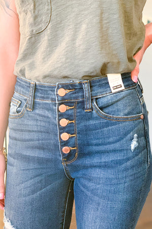 Get your spring on with our Judy Blue High Rise Distressed Button Fly Cuffed Skinny Jeans!  Exposed button fly, light distressing, and cuffed hems give these skinny jeans the cutest look EVER!  Pairs easily with a graphic tee and sneakers or wedges for a casual day at the park outfit.