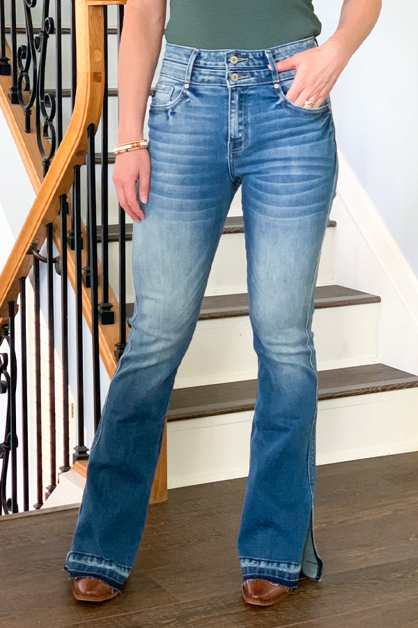 Every woman needs a staple pair of flare jeans! Our Curvy Double Button Flare Jeans With Side Slit by KanCan will be your go-to flares this season!  Featuring slight wiskering, fading, one-inch hems, slits on outer sides, and high rise waistline with double button closures, contrast stitching, and a 5-pocket design.  These flares have a curvy fit so there is a little more room through the hips and thigh area.